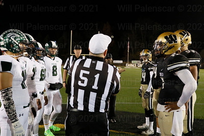 Captains of South County on left and Westfield on right watch the coin toss at the start for the South County - Westfield