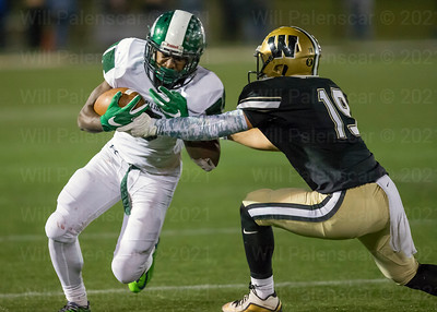 Nicholas DiVecchia #19  reaches for ball of South County ball carrier