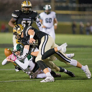 Westfield's Cole Roberson #42 forces the fumble of South County receiver Seth Dunn #81