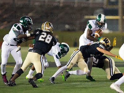 South County  runner appears to have lost a grip on the ball as Westfields defense delivers a hit