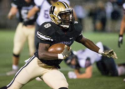 Eugene Asante #8 carries the ball for Westfield
