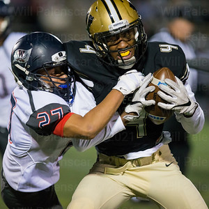 Ivory Frimpong # 4 secures ball from WT Woodson defender Isaiah Barnes #27