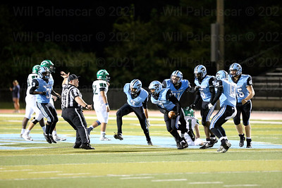 The Centreville Wildcats celebrate with Tre Maxwell #7 after an interception