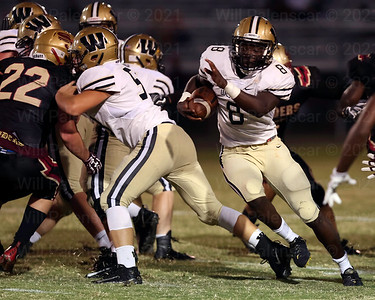 Eugene Asante #8 carries the ball for Westfield.