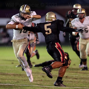Stonewall Jackson defender Cj Simmons #5 tries to get a hand in pulling down Noah Kim #10