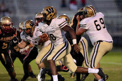 The Westfield offensive line makes a lot of running room for Eugene Asante #8. Asante rushed for 110 yards.