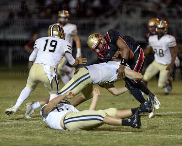 Conor Newborn #38 wraps up a Stonewall Jackson ball carrier.