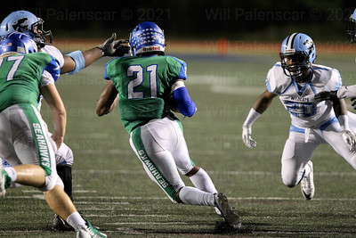 Spencer Alston tries to avoid two Centreville defenders in Friday nights home loss with Centreville.