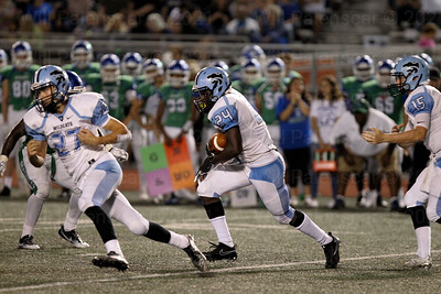 James Gangi #27 blocks for Centreville teammate Bassie Kanu #24 who carries the ball for Centreville