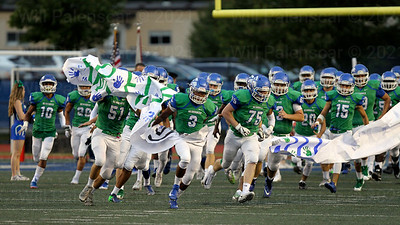 South Lakes bursts onto the field prior to their non conference game with Centreville on 9-22