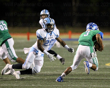 Kalin Jean#20 of Centreville tries to contain South Lake QB Devin Miles #3.