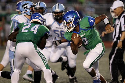 South Lakes QB Devin Miles #3 runs for positive yardage in his teams 30-14 loss to Centreville on 9-22.