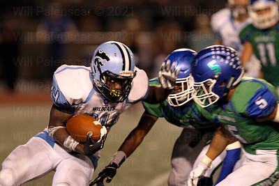 Bassie Kanu #24 prepares for a hit by two South Lake defenders.
