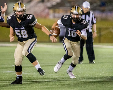 Westfield QB Noah Kim #10 runs for positive yardage in game with Patriot