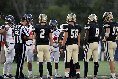 Team captains from Westfield and Patriot meet at midfield