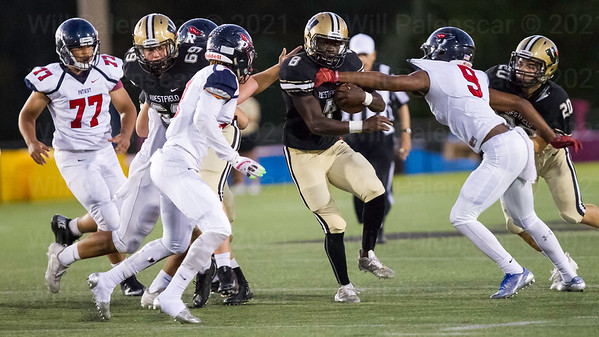 Eugene Asante powers his way up the field for Westfield. Asante would carry the ball 24 times for 195 yards and 2 TD's.
