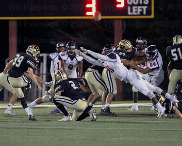A Patriot HS special teams just misses the block of a Westfield extra point.