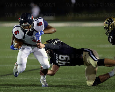 Dylan Winesett #49 pulls down Bo Giwa #6 in Westfield win over visiting Patriot.