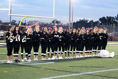 The Westfield HS Varsityh Cheerleaders stand for the national anthem