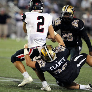 Joe Clancy #36 pulls down Madison QB Patrick Berry #2