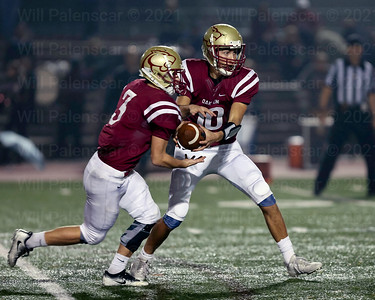Paul Campo Jr hands the ball to Jared Cole #3