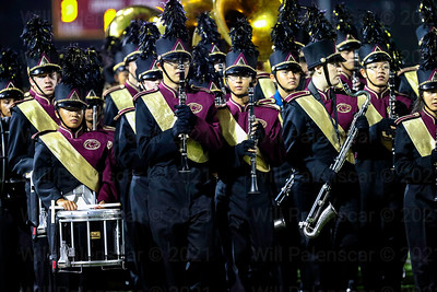 The Oakton Cougars marching band perform at halftime of their homecoming game with Westfield