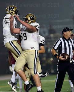 Bryan Jewell #69 and Bizzet Woodley celebrate Woodley's touchdown recption.