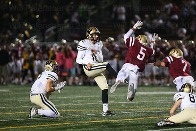Marcus Cruz #5 and Ryan Harris #7 attempt to block the extra point of Westfield kicker