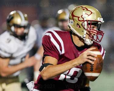 Oakton QB Paul Campo Jr looks down the field as he tries to escape the Westfield pass rush.
