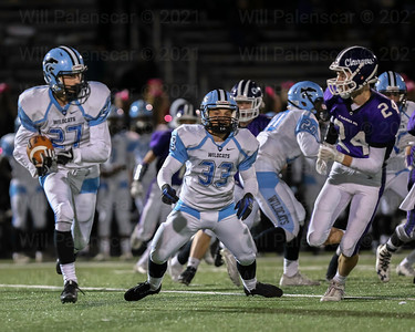 James Gangi #27 carries the ball for visiting Centreville