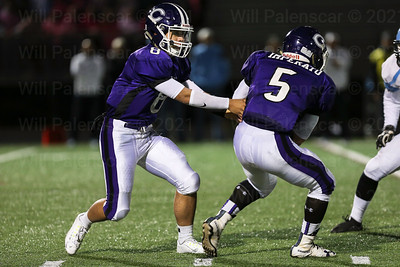 Chantilly QB , Ethan Bae #8 hands the ball off to RB Joey Imperato #5