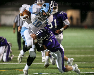 Charlie Salette #10 overpowers Chantilly's Steven Risi for one of his two rushing TD's