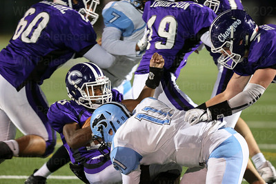 Pierre Johnson #28 is tackled by Centreville's Nick Kuzemka311