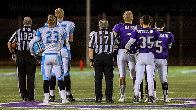 Team captains for Centreville and Chantilly show their respect during the playing of the National Anthem.