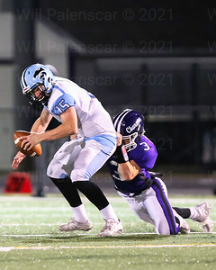 Christian Parana #3 pulls down Centreville QB Presley Egbers.