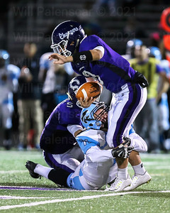 Nick Kuzemka #111 appears to have Chantilly QB Ethan Bae #8 wrapped up.