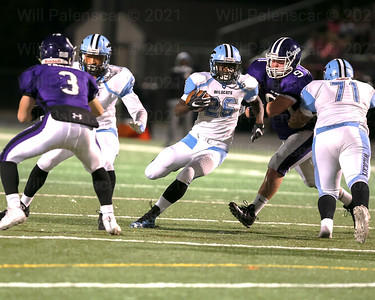 The Chantilly defense of Raymond Schircliffto #91   and Christian Parana #3 stop the running of Bassie Kanu #26