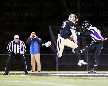 Westfield's Taylor Morin #2  blocks the punt of Battlefield punter Ryan Feehan  #14, then catches the block in the endzone with 7:16 to play in the 2nd quarter to open scoring.