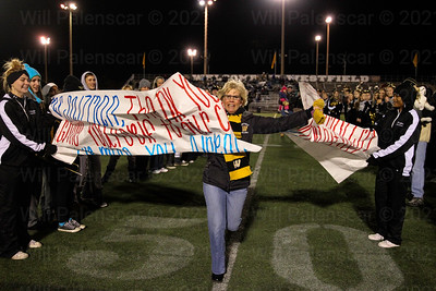 "Sherryl Salzman runs through a banner made by the students at Westfield HS. that read, ""Ms. Salzman, Thank you for graciously giving yourself to our community!! We Miss you already!!"""