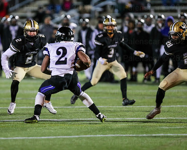 Jonah Seagears #2 looks for running room while Taylor Morin #2 , Saadiq Hinton #3 and Isarael McClain #28 leave no gaps.