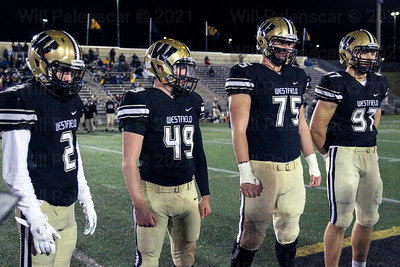 Westfield team captains Taylor Morin #2, Dylan Winesett # 49, Harmon Saint Germain #75 and Nolan Cockrill #97  stand at midfield before the coin toss.