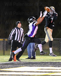 Bizzett Woodley #17  elevates  for a pass in the end zone ,while a Battlefield player defends.