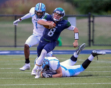 South County QB Matthew Dzierski #8 avoids being brough down by Centreville's Joey Purvis #52