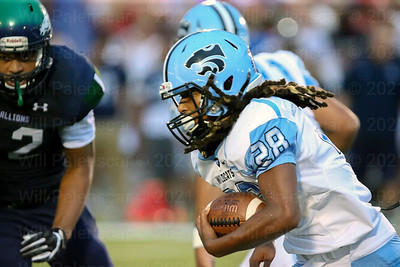 Anthony Ramos #28 carries the ball for the visiting Centreville Wildcats