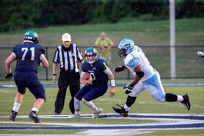 Gavin Thomas #78  of Centreville looks to bring down South County QB Matthew Dzierski #8