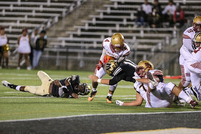 Dylan Gepford #11 puts his head down as he hits Xander Albea #4