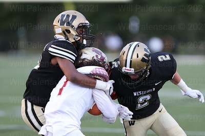 Westfield teammates Tahj Sumney # 38  and Taylor Morin #2 are able to take down the Stonewall Jackson ball carrier