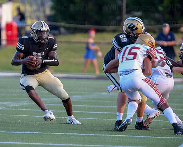 Eugene Asante #8 carries the ball for Westfield as teammate Brian Jewell #69 makes lane for him to run