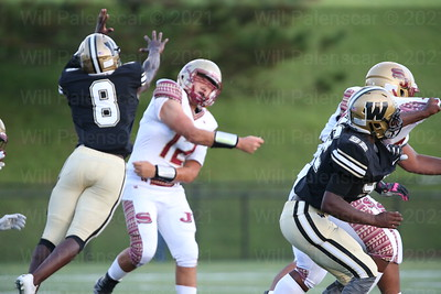 Eugene Asante #8 pressured Stonewall Jackson QB Toviel Jung #12 to get rid of ball just before Asante can sack the quarterback