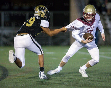 Caleb Wheatland #29 pulls on the jersey of QB Chris Neary #7 , Wheatland forced a fumble which Neary would recover deep in Oakton territory.